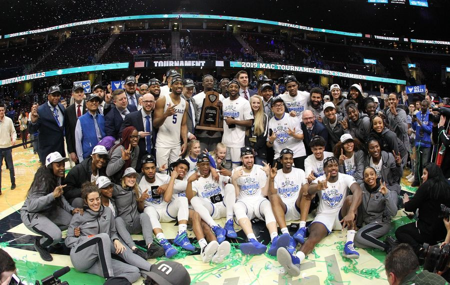 The MAC Champion UB Bulls men's and women's teams celebrate together Saturday. (James P. McCoy/Buffalo News)