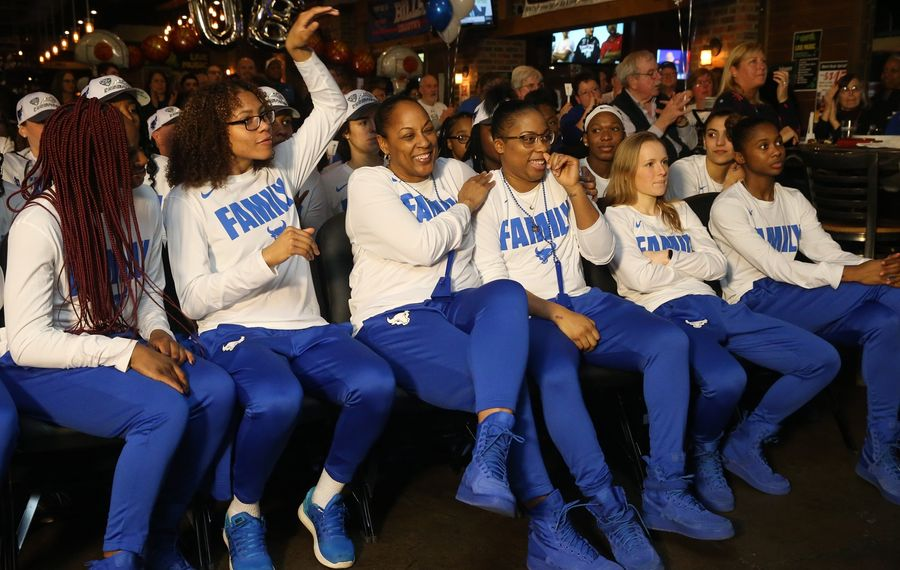 The UB women's basketball team gathered Monday in Santora's Pizza Pub and Grill on Transit Road to find out who they'd be playing in the NCAA lineup — but a leak spoiled the surprise. (John Hickey/Buffalo News)