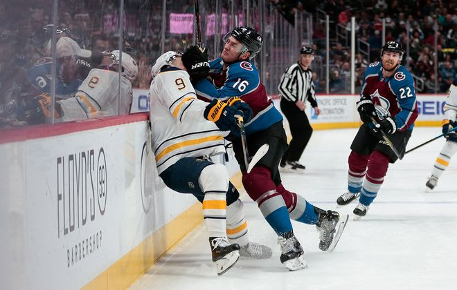 Avalanche defenseman Nikita Zadorov (16) checks Sabres center Jack Eichel (9) into the boards in the first period at the Pepsi Center. (Isaiah J. Downing/USA TODAY Sports)