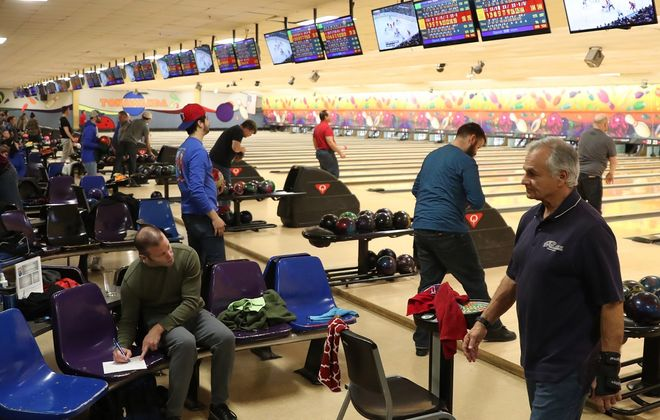 "Jeff Miers writes, of places like Tonawanda Bowling Center, ""Around here, people still love to bowl, even if the blue-collar jobs they packed the alleys to forget about for a while are, largely, long gone."" (Sharon Cantillon/Buffalo News)"
