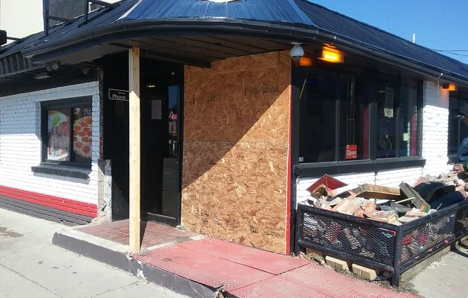 Temporary repairs were made to Destiny's restaurant after a vehicle crashed into the building on Saturday. (Matt Glynn/Buffalo News)