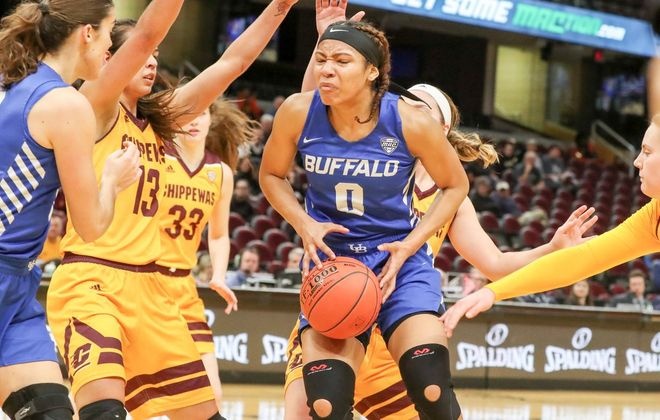 UB forward Summer Hemphill (0) scores against Central Michigan guard Maddy Watters (4) in the first quarter of a MAC Tournament semifinal Friday at Quicken Loans Arena in Cleveland. (James P. McCoy/Buffalo News)