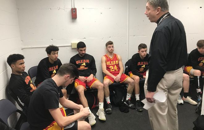 More Olean coach Jeff Anastasia talks with his team prior to playing Glens Falls in a New York state Class B semifinal. (Harry Scull Jr/ Buffalo News)