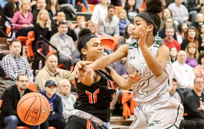 Lake Shore's Noelani Cornfield stuffs a shot by Amherst's Amaya Woods during the second half. (James P. McCoy/Buffalo News)