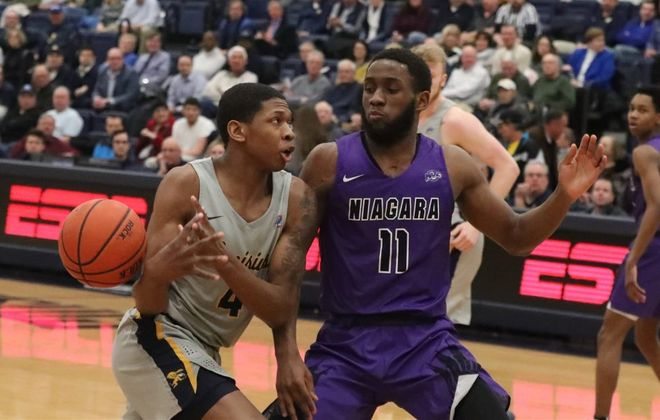 Marvin Prochet finished his four seasons at Niagara averaging 10.6 points, and 6.5 rebounds, and had 19 double-doubles, including 11 points and 12 rebounds Thursday against Monmouth in a MAAC Tournament game. (James P. McCoy/News file photo)