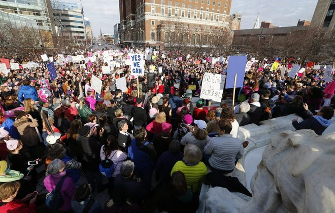 People attend the Women's March  sponsored by the WNY Peace Center in Niagara Square Saturday, Jan. 21, 2017. (Mark Mulville/The Buffalo News)