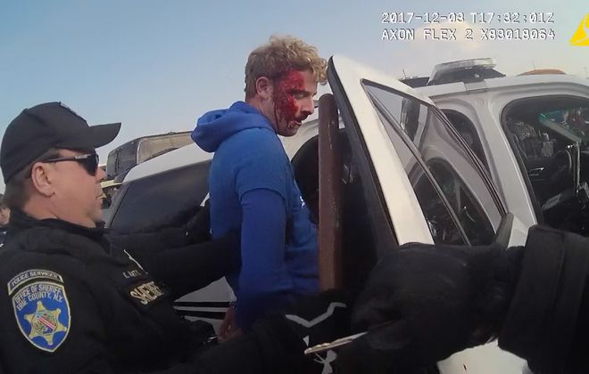 Prosecutors are weighing whether to charge Erie County Sheriff's Deputy Kenneth P. Achtyl, left, in the December 2017 arrest of Nicholas H. Belsito, shown here in a still from body camera video.