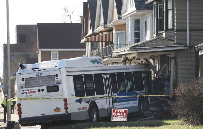 An NFTA Metro bus crashed into a house at 1798 Bailey Ave. at approximately 10:45,  Friday. (Sharon Cantillon/Buffalo News)