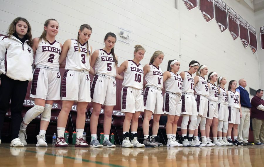 The Eden girls basketball team pays tribute to Amy Banks, a guidance counselor who died over winter break prior to playing Springville at Eden high school on Monday, Jan. 7, 2019. (Harry Scull Jr./ Buffalo News)