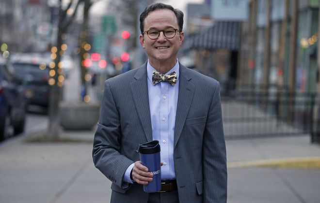 Stephen Seerey is assistant branch manager at M&T Bank, 709 Elmwood Ave. A classic suit accessorized with a bow tie is a favorite look.  (Robert Kirkham/Buffalo News)