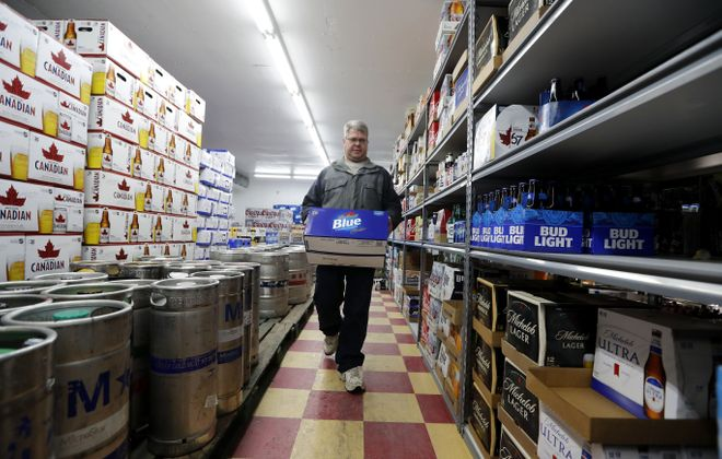 Shaun Sweet grabs a case of beer at the Sheridan Dr Consumer's Beverages in Amherst Saturday, Jan. 19, 2019. (Mark Mulville/Buffalo News)