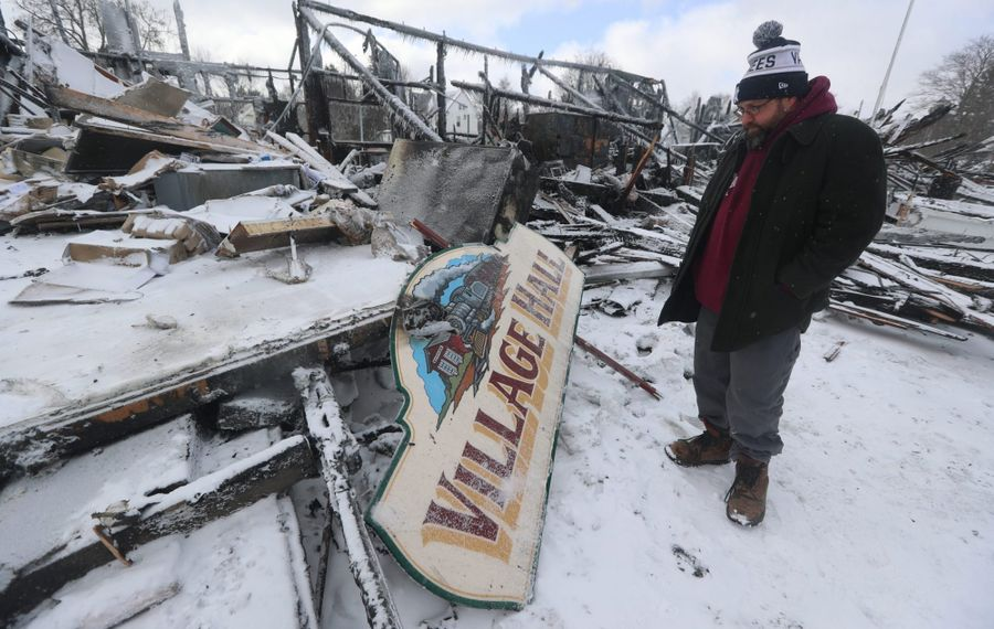 Barker Mayor Aaron Nellist looks over the ruins after a fire destroyed Barker's Village Hall and public library on Jan. 21, 2019. (John Hickey/Buffalo News)