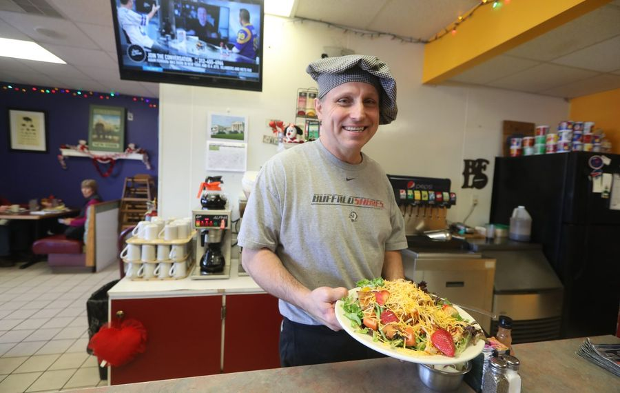Joe Bald, owner of Buffalo Joe's Cafe in Clarence, displays the oriental chicken salad. (John Hickey/Buffalo News)