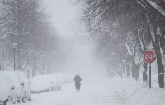 A woman walks up Sterling Avenue in North Buffalo on Wednesday, Jan. 30, 2019.  More snow could be coming our way this weekend. (Sharon Cantillon/Buffalo News)