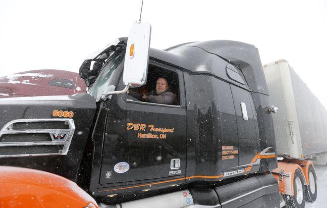 Doug Herve of Hamilton, Ont. waits out the truck/bus traveling ban at Jim's Truck Plaza in Cheektowaga Thursday, January 31, 2019.      (Mark Mulville/Buffalo News)