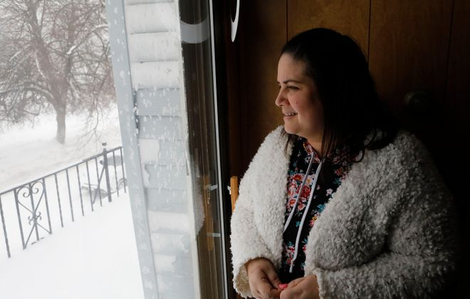 Yohalis Rivera, who moved to Buffalo from Puerto Rico in December because of difficulties her family had in recovering from Hurricane Maria, got her first taste of a Buffalo blizzard. (Derek Gee/Buffalo News)