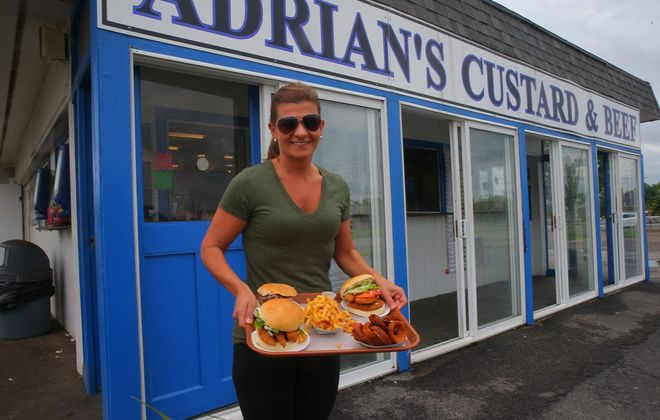 Customer Danielle Coats stands outside the former location of Adrian's Custard & Beef on Grand Island. (John Hickey/News file photo)