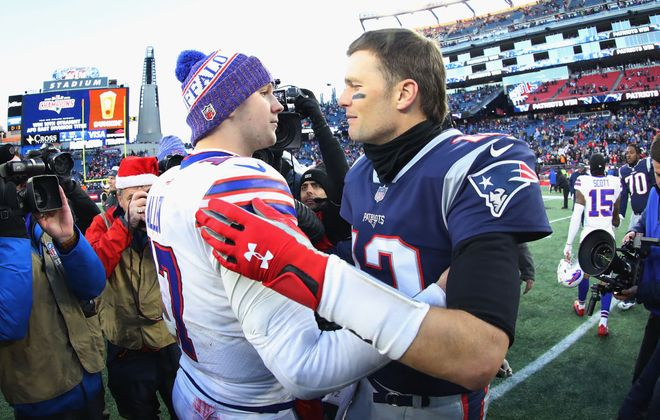 Josh Allen and Tom Brady meet on the field after the New England Patriots defeated the Buffalo Bills 24-12 at Gillette Stadium on Dec. 23, 2018, in Foxborough, Mass. (Getty Images)