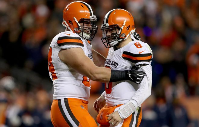 Browns center JC Tretter, left, took every offensive snap this season, blocking for rookie quarterback Baker Mayfield. (Getty Images)