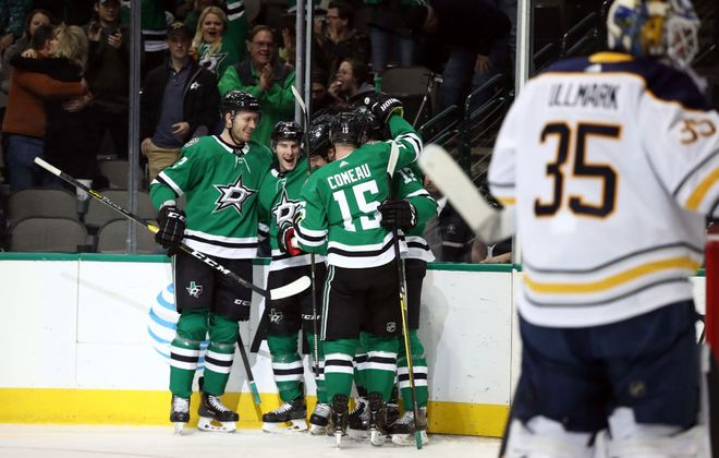 The Dallas Stars celebrate Jamie Benn's goal in the first period Wednesday night against the Buffalo Sabres. (Getty Images)