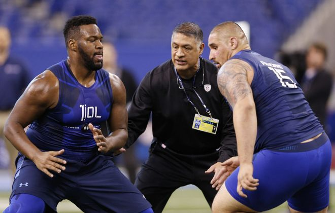 Juan Castillo, seen here running a drill during the 2015 NFL Scouting Combine, has been fired from his job as offensive line coach of the Bills. (Getty Images)