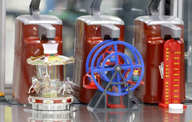 """What is believed to be the world's first, practical use """"ketchup dispensing robot"""" was officially unveiled to the media at last year's Erie County Fair as part of the """"I-Hub at the Fair"""" series of exhibits and experiences. (Robert Kirkham/Buffalo News)"""