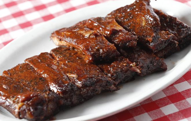 Dry rubbed and hickory smoked St. Louis ribs from Kentucky Greg's are part of the former barbecue restaurant's pickup pop-up Saturday. (Sharon Cantillon/News file photo)