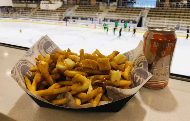 Pair the Power Play Poutine and a Hayburner from Big Ditch Brewing next time you're catching a sporting event at HarborCenter. (Erik Wollschlager/Special to The News)