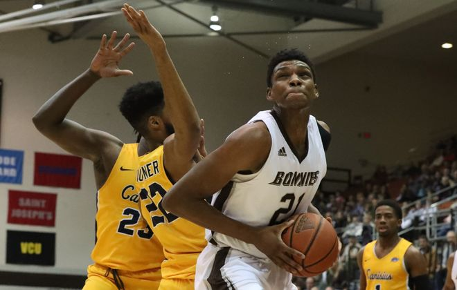 St. Bonaventure forward Osun Osunniyi rebounds the ball away from Canisius  forward Jibreel Faulkner at St. Bonaventure's Reilly Center on Wednesday, Nov. 28, 2018. (James P. McCoy/News file photo)