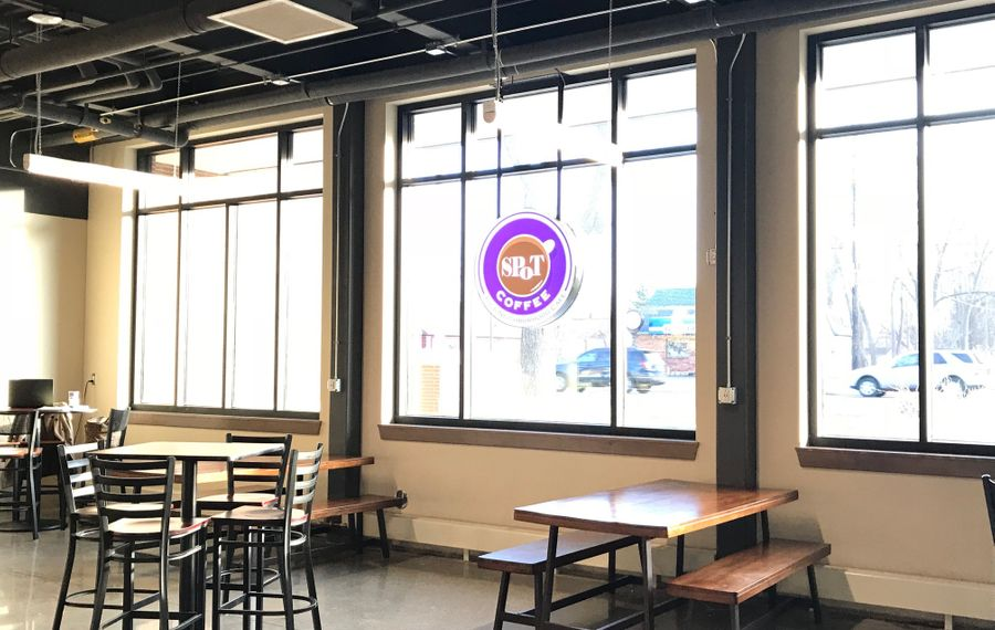 Light floods the new Spot Coffee Express Cafe at the West Seneca Community Center & Library. (Photo by Toni Ruberto/Buffalo News)