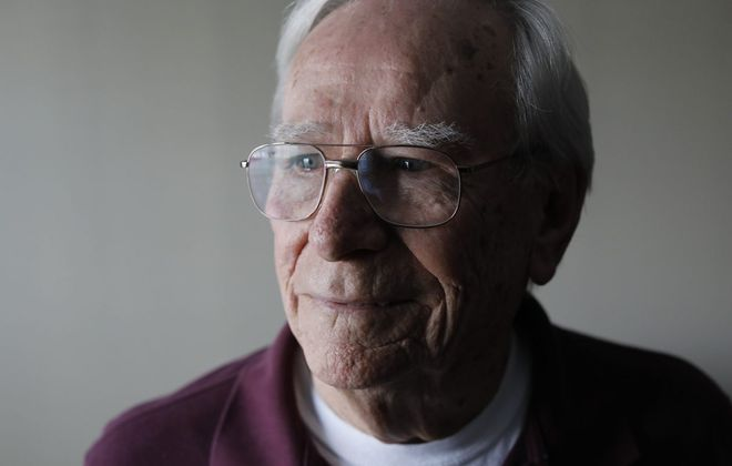 Korean War Army veteran Robert Fisher, who served from 1952 to 1954, talked about his service during an interview in his Amherst apartment last month. (Derek Gee/Buffalo News)