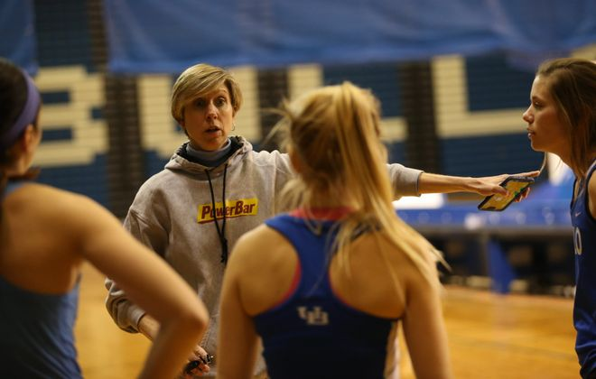 Vicki Mitchell, director of men's and women's track and field and cross country teams at UB, wishes she could make her team members get enough sleep. (News file photo)