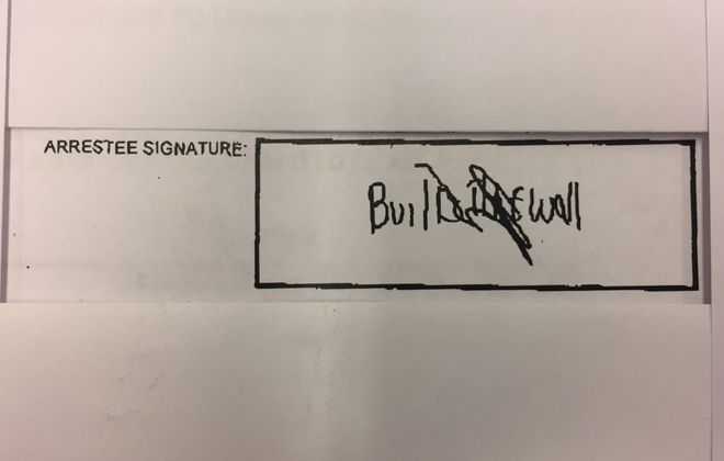 Scott M. Faith's signature on his arrest report stemming from Saturday morning's incident.