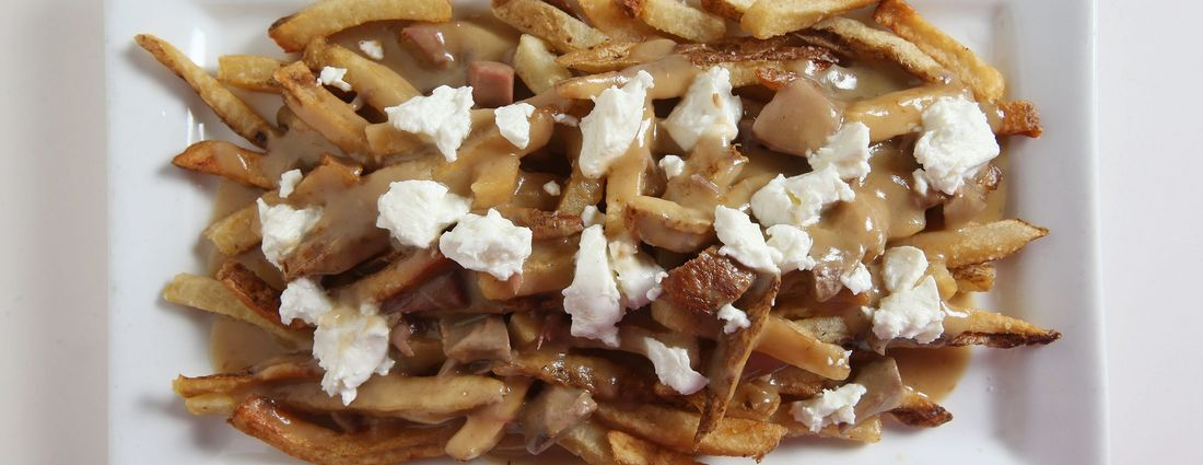 Richard Semonian, the chef-owner of Novel in Amherst, is a fan of the duck poutine at Winfield's Pub in Lackawanna. (Sharon Cantillon/Buffalo News)
