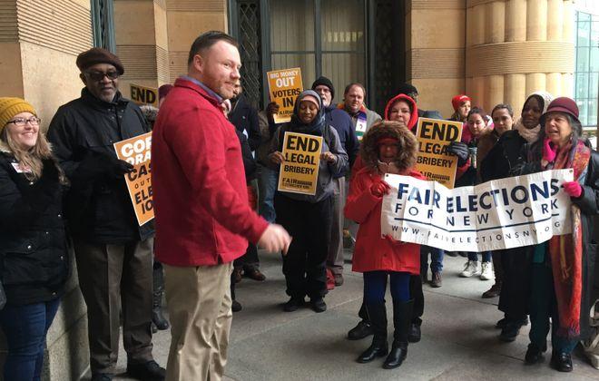 Assemblyman Patrick Burke joined fair election advocates at City Hall on Monday, Jan. 7, 2019. (Deidre Williams/Buffalo News)