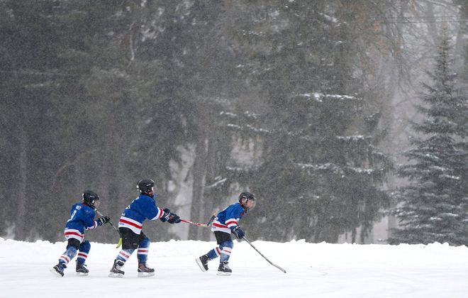 Members of the Buffalo Regals Rangers Mites have a skate at Como Lake Park in Lancaster on Jan. 19. (Mark Mulville/News file photo)