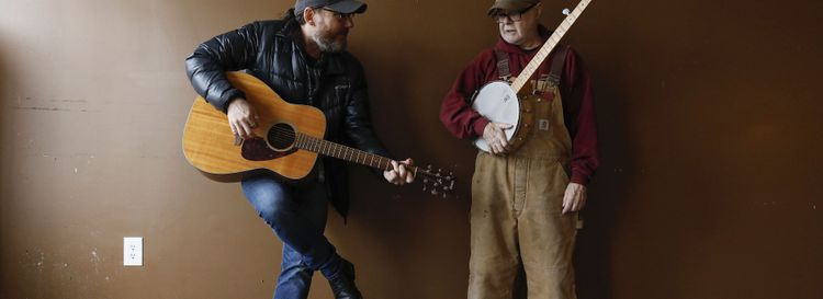 "Dave Ostrowski, left, known as ""Davey O,"" and Mark Buell, owner of Nickel City Arts in Akron, have built a music series dubbed Nickel City Sessions. (Derek Gee/Buffalo News)"