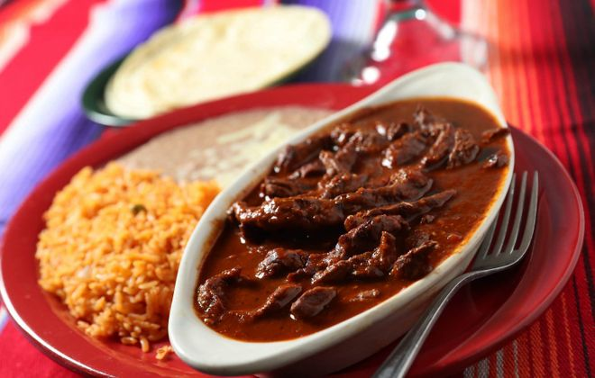 Rancho Viejo's chile Colorado is steak with red chile sauce, served with rice, beans and tortillas. (Sharon Cantillon/Buffalo News)
