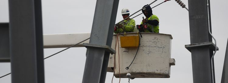 National Grid workers in the Gardenville Electrical Station in  West Seneca. (John Hickey/News file photo)