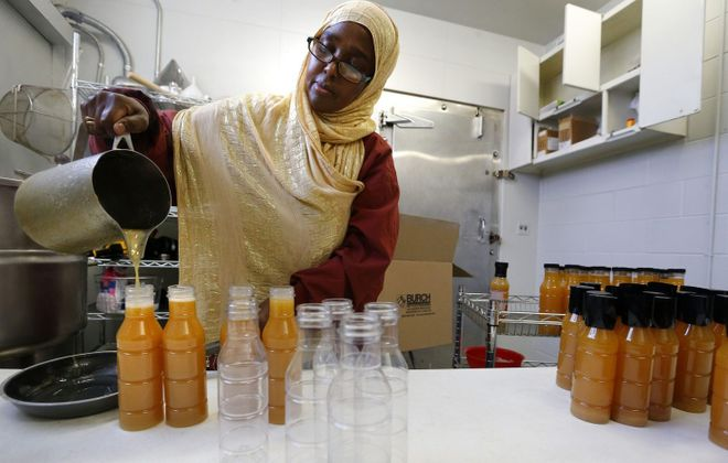 Somalian saucemaker Bisharo Ali is an example of the type of commercial producer who might operate out of the new Kitchen @ the Market. (Mark Mulville/News file photo)
