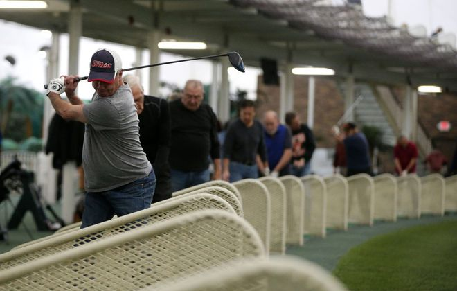Golfers practice their swings at the Paddock Chevrolet Golf Dome in the Town of Tonawanda. The facility has yet to reopen following an extensive renovation project that started in June. (Mark Mulville/Buffalo News file photo)