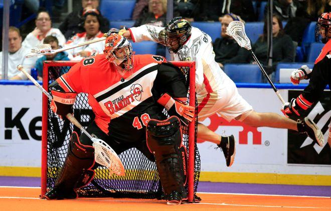 Buffalo Bandits goaltender Matt Vic stops Philadelphia Wings forward Blaze Riorden. (Harry Scull Jr./News file photo)