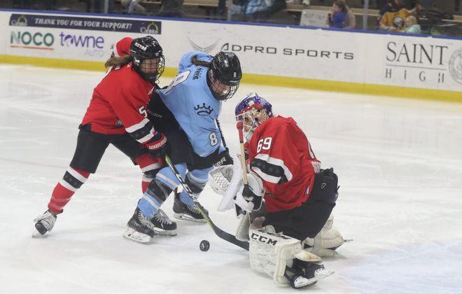 Kelly Babstock battles Metropolitan Riveters goalie Maria Sorokina and Jenny Ryan last season. (James P. McCoy/News file photo)