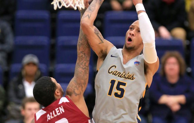 Canisius forward Takal Molson drives to the basket as he is being defended by Rider's Jordan Allen during the first half of a college basketball game at the Koessler Center on Friday, Jan. 11, 2019. (Harry Scull Jr./ Buffalo News)