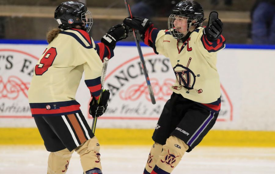 Williamsville forward Jenna Cavalieri celebrates with her teammates after she scored a goal in the first period against Potsdam in the state semifinals at Harborcenter. (Harry Scull Jr./Buffalo News)