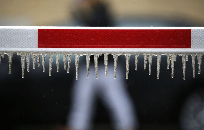 A thick sheet of ice caused hazardous driving conditions on Wednesday, Feb. 6. (Mark Mulville/Buffalo News)