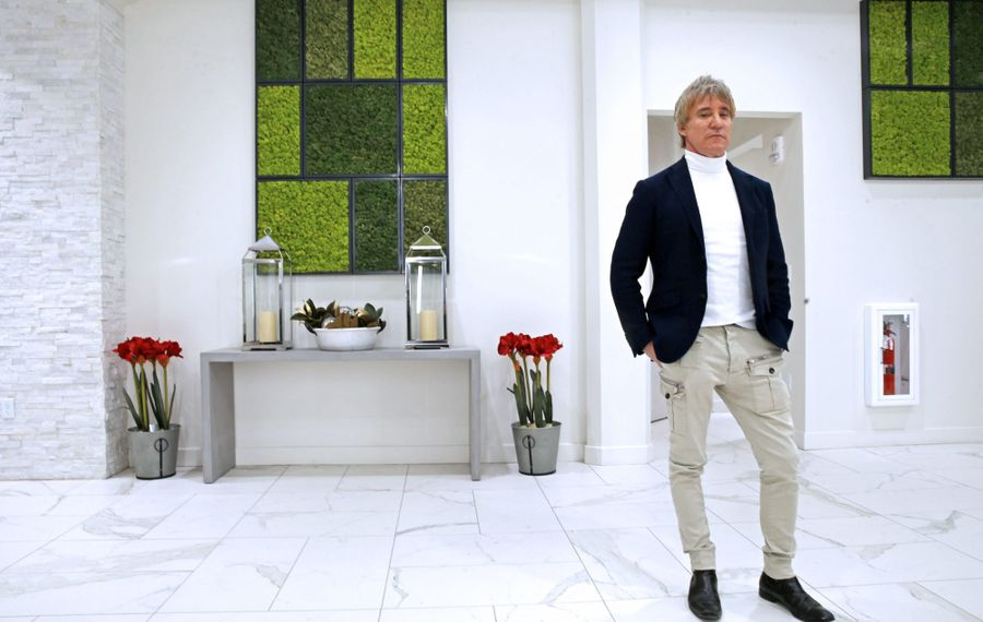 Jeffrey Wynn stands in the lobby of Cathedral Place at 298 Main St.  Wynn and his brothers are successful Canadian businessmen investing heavily in Buffalo. (Robert Kirkham/Buffalo News)