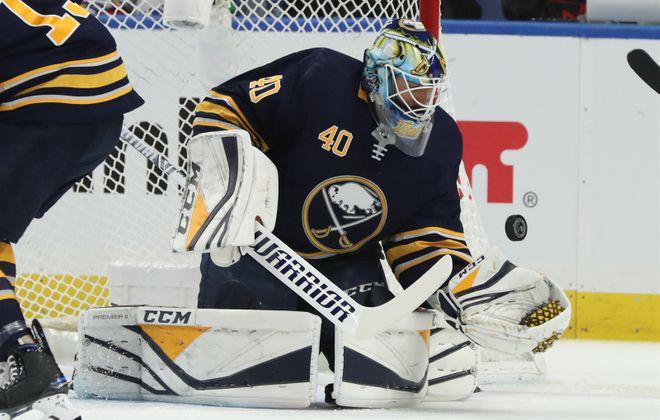 Buffalo Sabres goalie Carter Hutton stops a shot Saturday against the Washington Capitals in KeyBank Center. (James P. McCoy/Buffalo News)