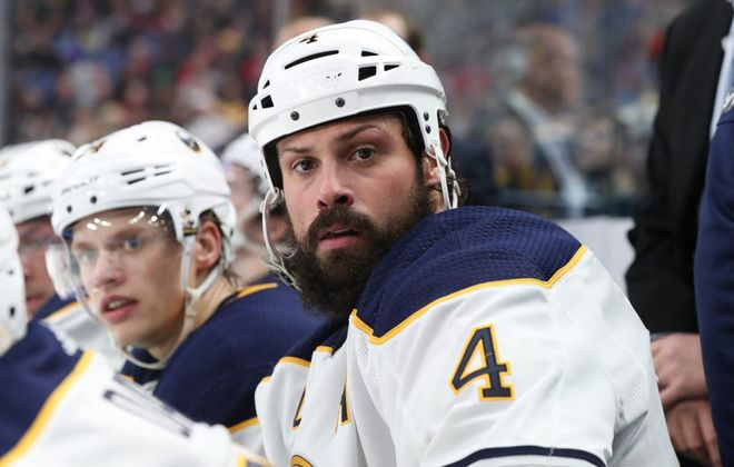 Sabres defenseman Zach Bogosian looks on from the bench at KeyBank Center on Feb. 7, 2019. (James P. McCoy/News file photo)