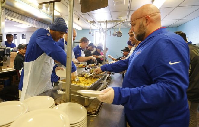 Bills coaches Jim Salgado (left) and Brian Daboll took part in an event the Buffalo City Mission   (Mark Mulville/Buffalo News)